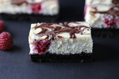 Nutella Swirl Cheesecake with Oreos and Raspberries